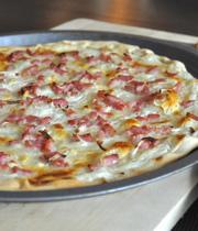 Flammekueche (thin crusted cheese, onion and bacon tart)