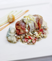 Veal and smoked bacon roulade with gorgonzola and dried apricots