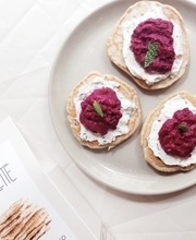 Marlette Blinis, beet hummus and fresh goat cheese