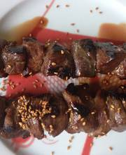 Grilled sesame-duck skewers