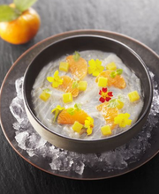 Sea bream carpaccio with sweet and sour Corsican clementines on ice