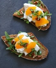 Crostini with burrata, arugula, mandarin, and mint