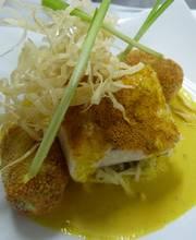 Acoupa weakfish filet with Colombo powder seasoning, coconut sauce, cooked in green papaya with sweat potato croquettes