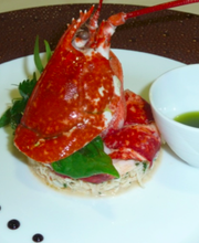 Blue Lobster with Crab, enhanced with cumbawa, garden herbs and basil oil