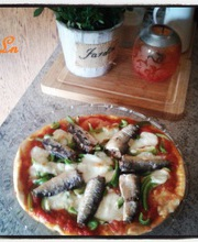 Pizza with sardines