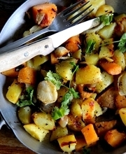 Potato, sweet potato and unpeeled garlic sauté