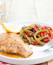 Pan-fried veal with lemon and sautéed bell peppers