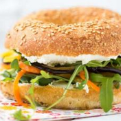 Vegetarian bagel with eggplant and red bell pepper-carrot julienne