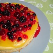 Lemon curd cheesecake with red fruit berries
