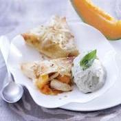 Chicken in phyllo crust on warmed melon with basil ice-cream