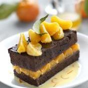 Rich chocolate fudge cake with Corsican clementines