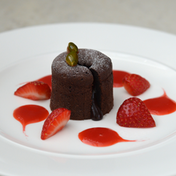 Chocolate Lava Cake with Strawberry Coulis and Caramelized Pistachios