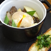 Soft-boiled egg in cocotte with lentils, sautéed vegetables and morel sauce
