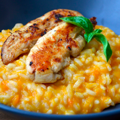 Butternut squash risotto with spicy chicken slithers