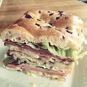 Olive-onion fougasse (or focaccia) and mortadella sandwich