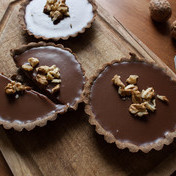 Milk Chocolate tartlets with buck wheat crust