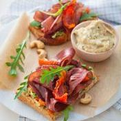Farmhouse bruschetta with bresaola, arugula and basil-cashew cream