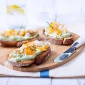 Avocado mousse toast with smoked fish