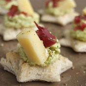 Saint Nectaire cheese toasts with pickle tapenade and Auvergne ham