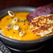 Red kuri pumpkin soup with bacon and Emmental crisp