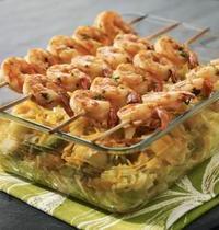 Brochettes de crevettes marinées à l'Arome et fondue de légumes