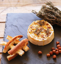 Baked camembert with honey and rosemary
