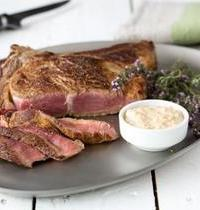 Rib of beef on the grill with creamy cider sauce