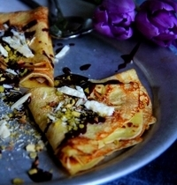 Coconut, Toblerone® chips and pistachio crêpes
