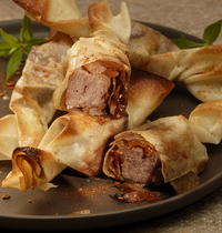 Beef tongue with candied shallots in brick pastry sheets