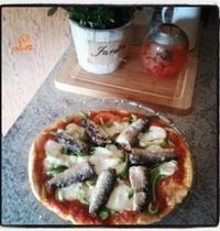 Pizza with sardines