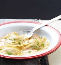 Shrimp ravioli in coconut nage