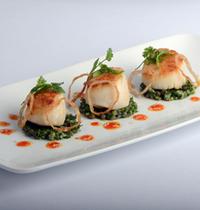 Seared scallops, ocean tartare, fried shallots with a saffron vinaigrette